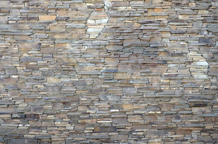 Modern pattern of flatten stone wall decorative surfaces in brown color