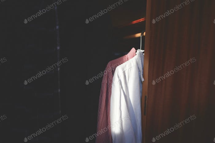 Shirts hanging in a wardrobe.