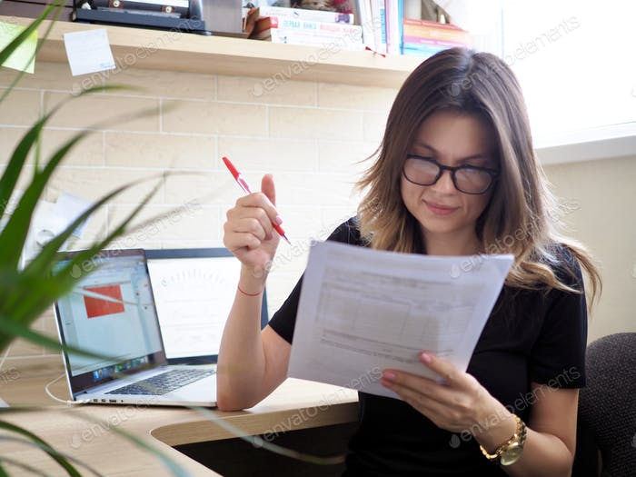 Business woman correct a contract