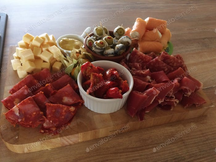 Tapas on a wooden plate