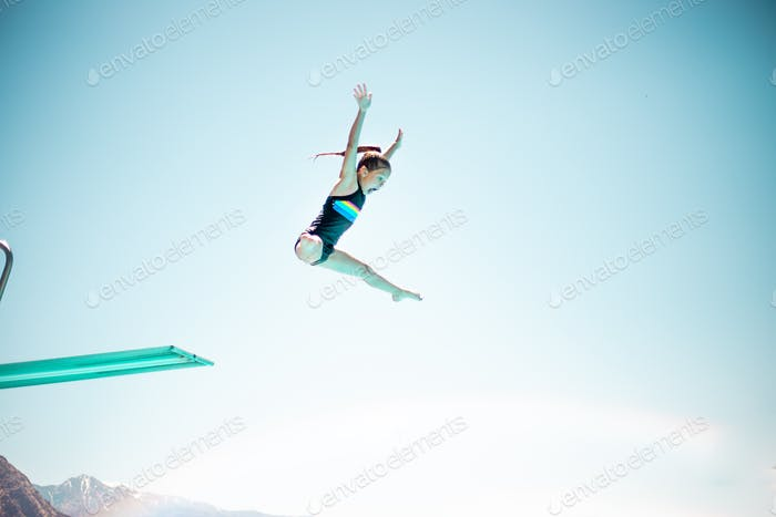 Girl going off diving board