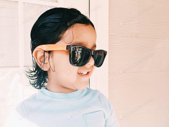 Stylish kid in sunglasses