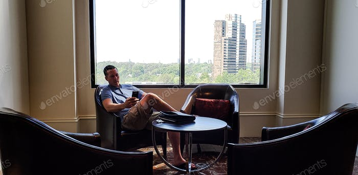 Alone he sits in Atlanta.