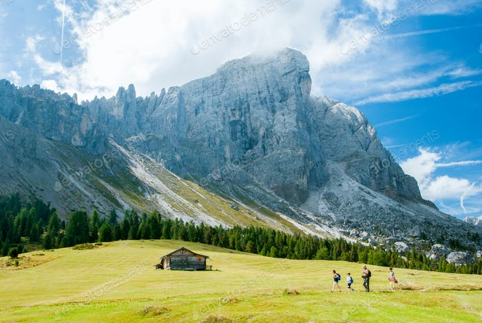 St. Magdalena, Italy - August 2, 2015: Family takes an excursion to the base of the Dolomites