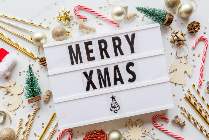 Merry xmas text on lightbox. Christmas winter holiday flat lay with accessories