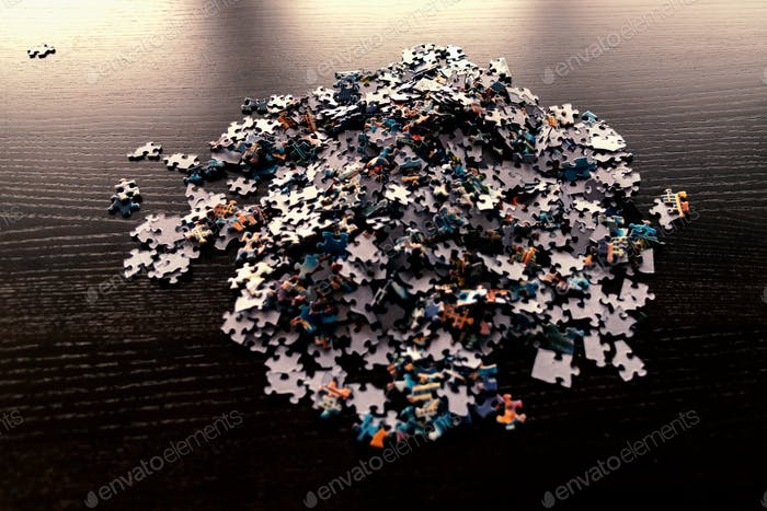 Puzzle pieces in large pile