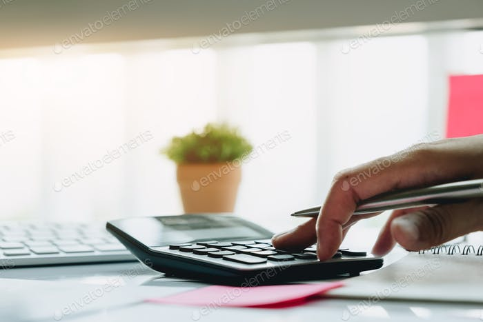 Close up view of bookkeeper or financial inspector hands making report