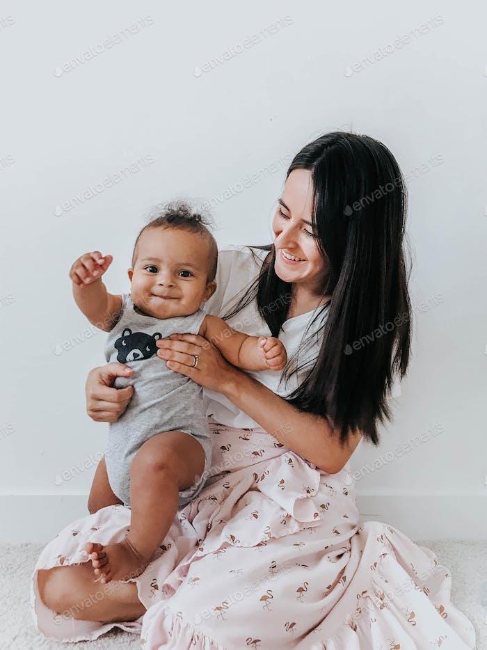 Happy Latina mom and baby boy