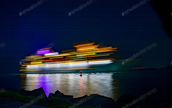 A cruise ship coming down waterway to port taken at slow shutter speed.