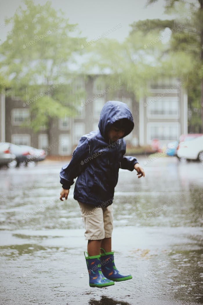 Kid playing in rain
