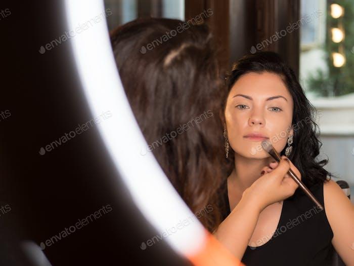 Makeup artist working