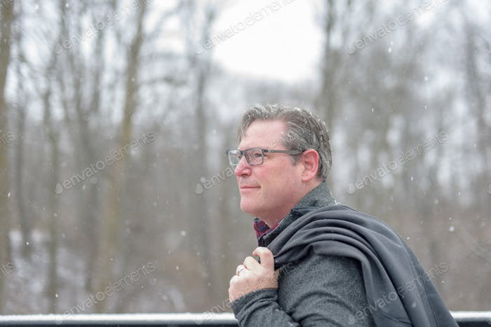 Adult man outside during snowfall - people in winter