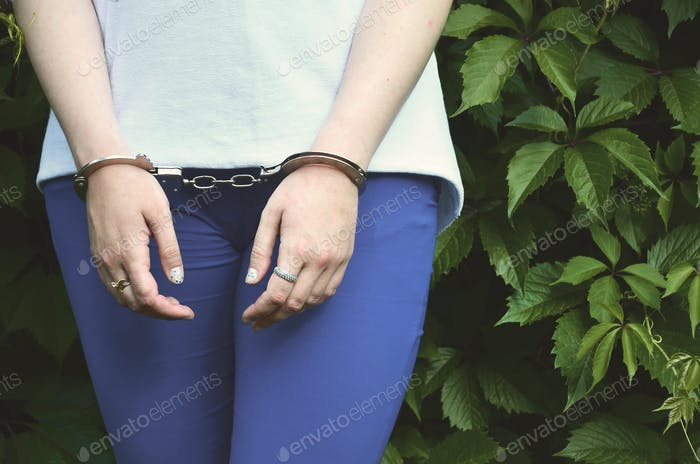Fragment of a young criminal girl