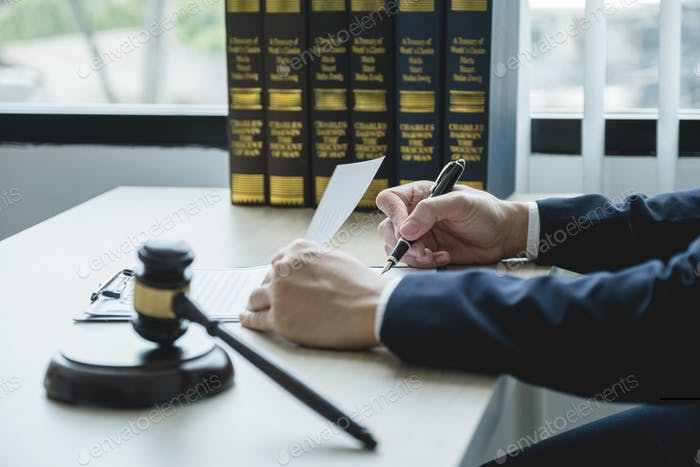 Lawyer hand holding pen and providing legal consult business dispute service at the office