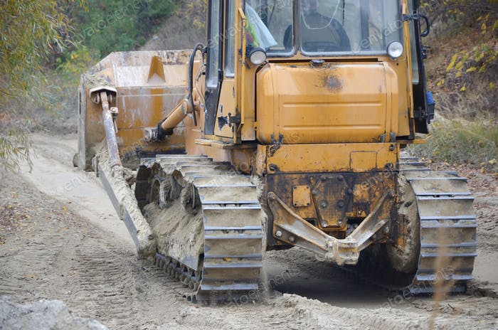 Quarry aggregate with heavy duty machinery on Construction industry