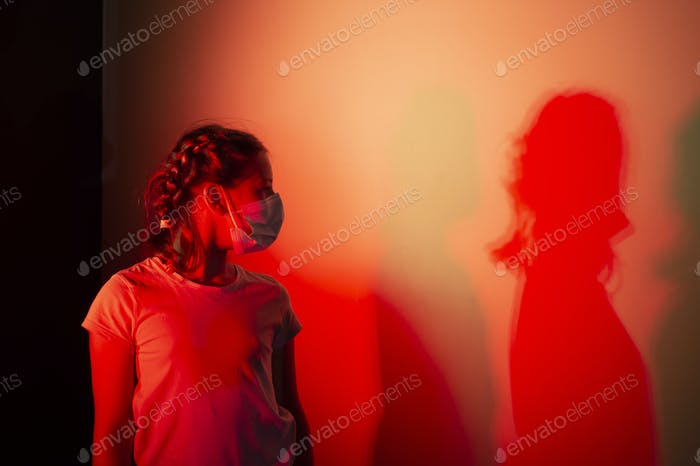 Girl looking at her shadow
