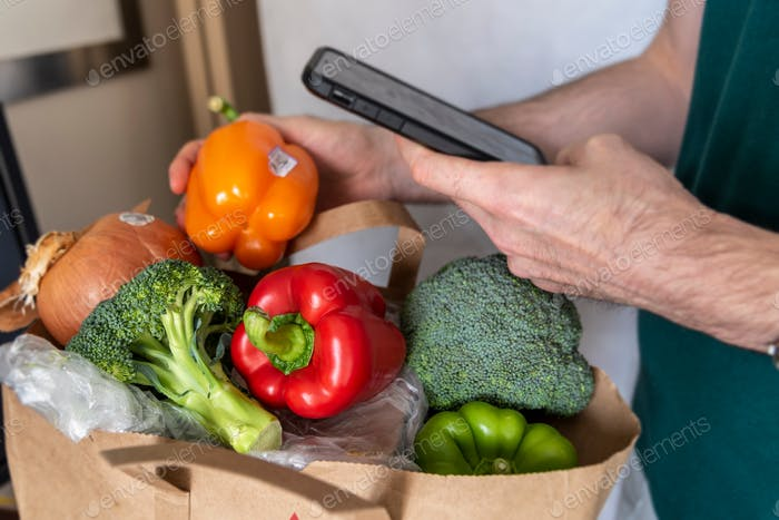 Scanning produce with device
