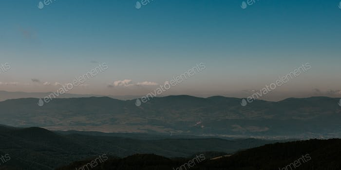 Panorama of a mountain range at blue hour