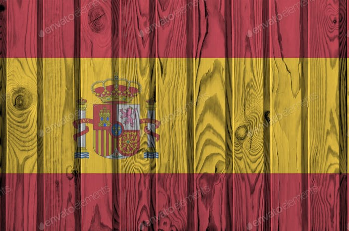 Spain flag depicted in bright paint colors on old wooden wall close up