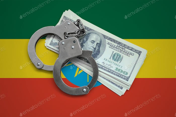 Ethiopia flag  with handcuffs and a bundle of dollars