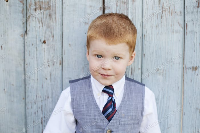Dapper little red headed boy.
