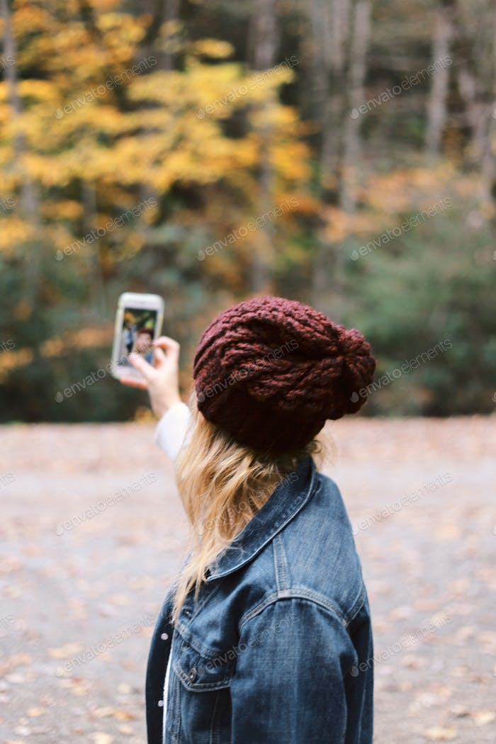 Girl taking a selfie on an iPhone