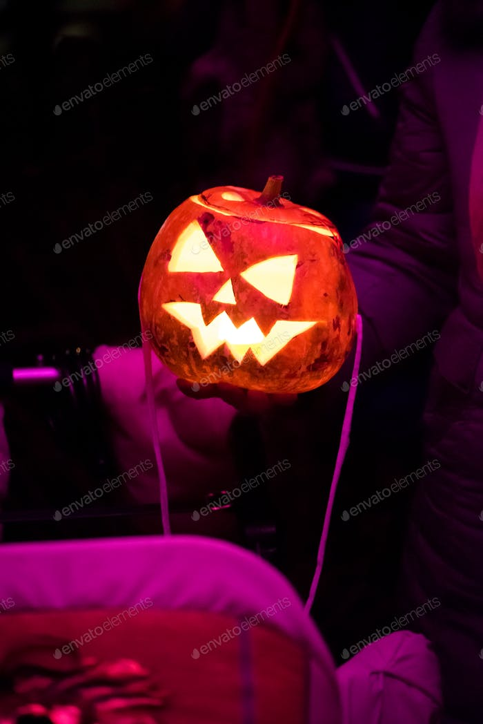 Spooky halloween pumpkin, Jack Lantern, with an evil face and eyes