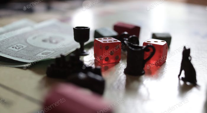 A closeup of monopoly board game pieces