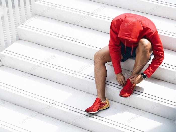Sport man running in the city.
