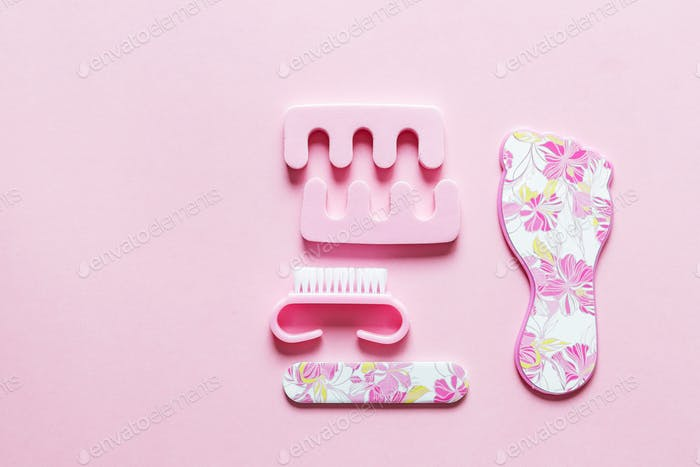 Set for pedicure lying on pink background ⭐️⭐️⭐️ Nominated ⭐️⭐️⭐️ Cosmetic cosmetology dermatology