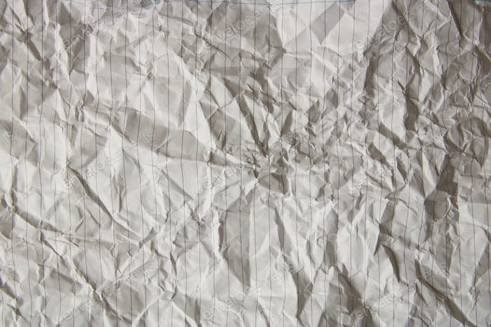 Crumpled up lined paper