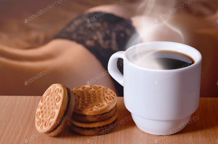 A cup of hot coffee and round cookies with a silhouette of a sexy girl in black underwear in the