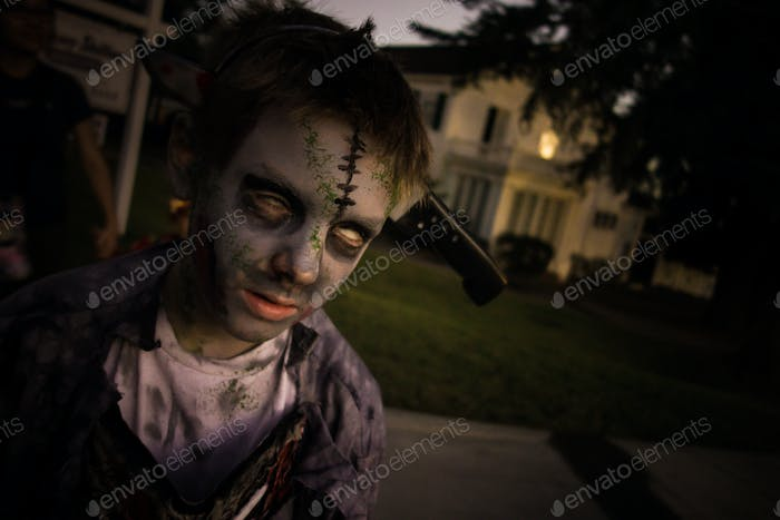 Kid zombie out on Halloween for some tricks or treats