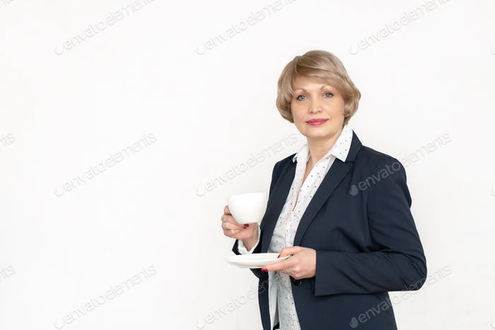 Beautiful businesswoman with blond hair color 48 years with a cup of morning coffee on a white
