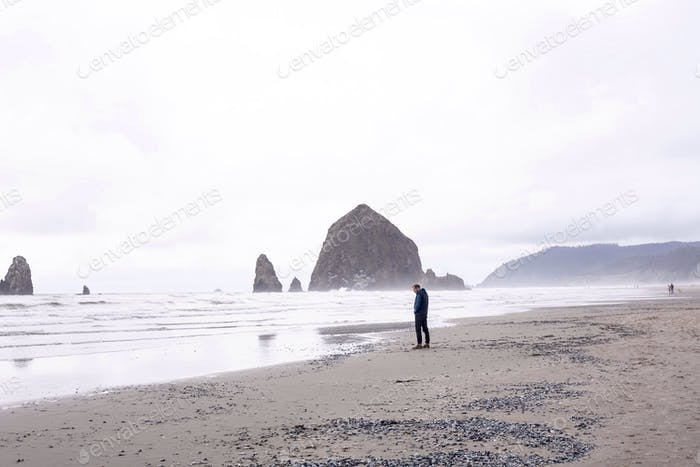Overcast stroll on beach near Haystack Rock, Oregon in the Pacific Northwest