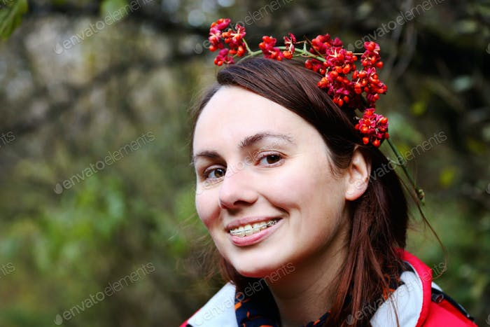 Woman wearing adult braces smiling