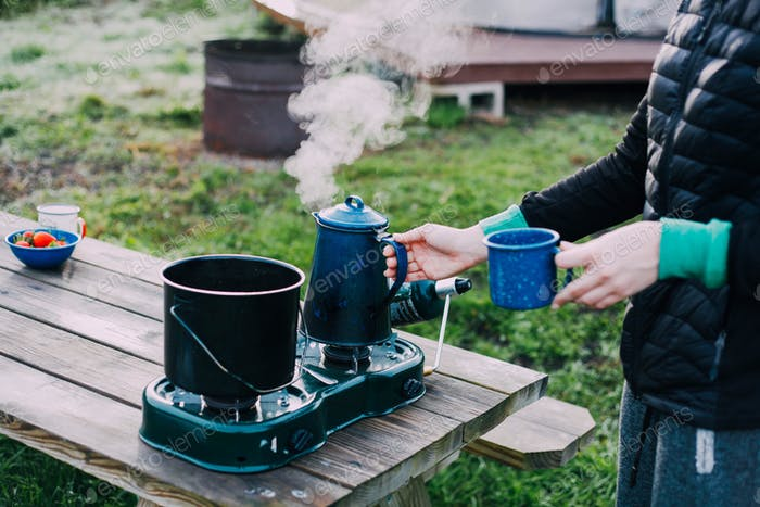 Making coffee at the campsite.