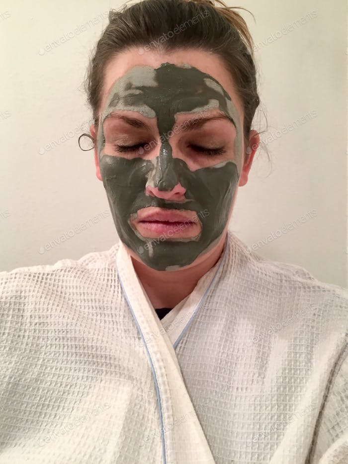 Woman with mud mask on