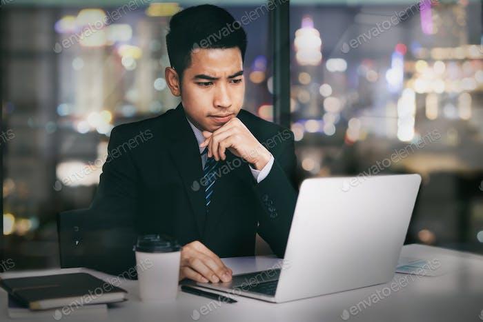 Businessman working at night.