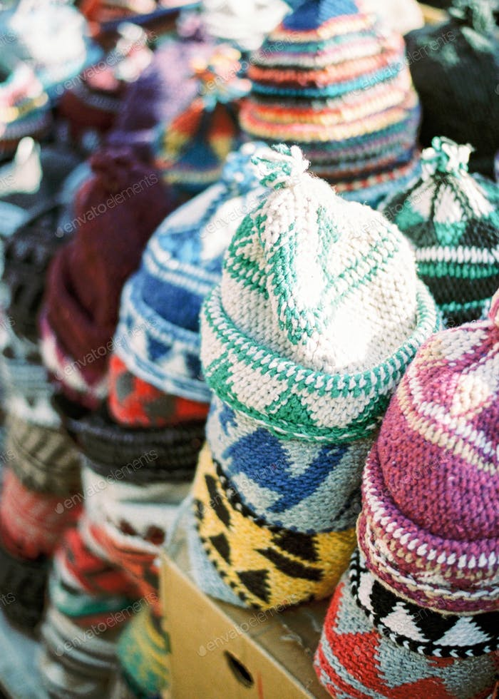 Knitted hats on berber market in Morocco Marrakech