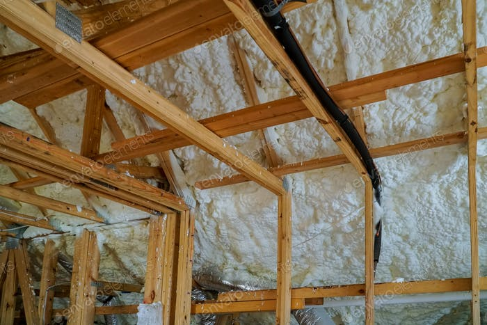 Installing thermal foam insulation under the roof foam wool panels and polyurea Spraying