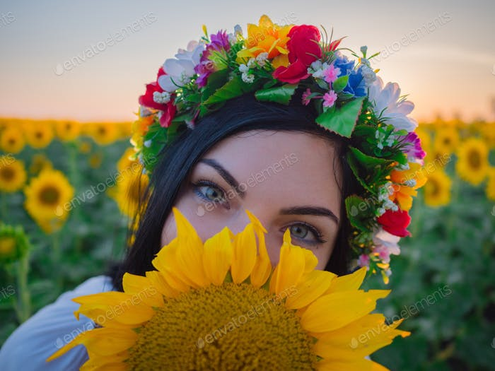 Woman's face with big sunflower