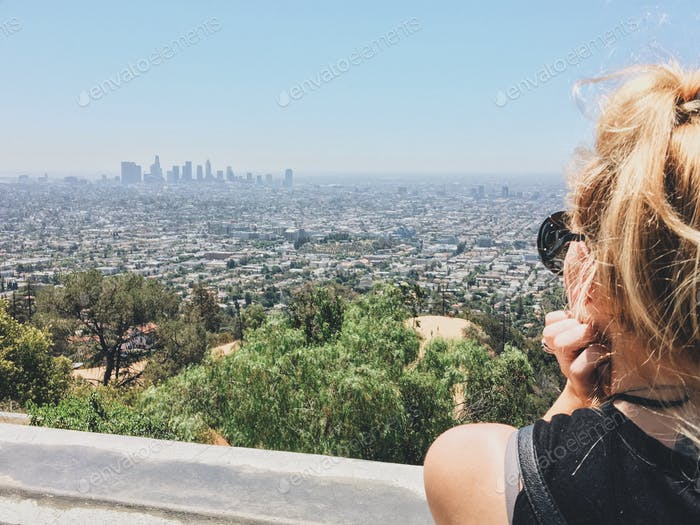 A woman takes in the view of downtown Los Angeles from Griffith Observatory.
