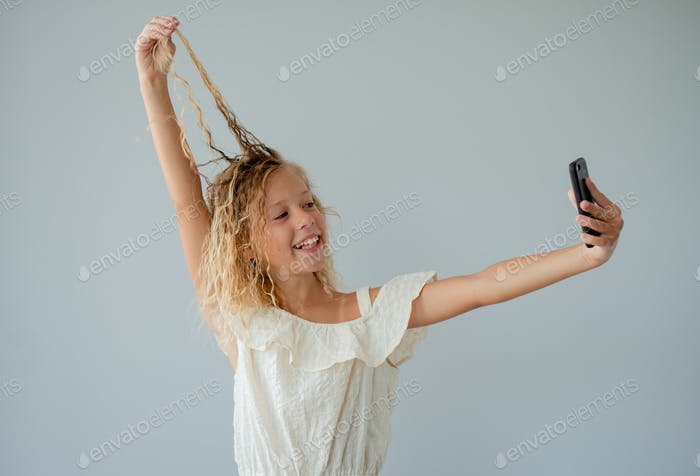 girl takes a selfie on the phone