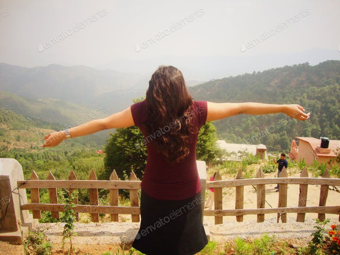 Young woman enjoying the outdoors and hill mountain scenery #wanderlust