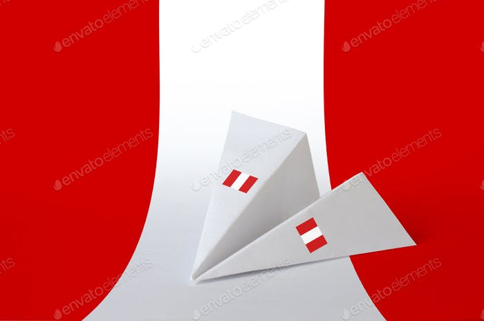 Peru flag depicted on paper origami airplane. Oriental handmade arts concept