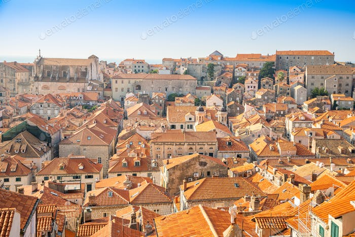 View of Dubrovnik red roofs in Croatia at sunset light, travel background