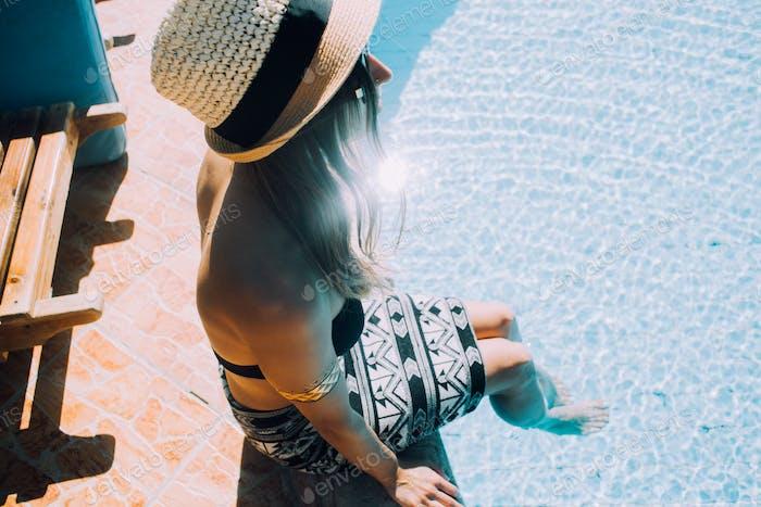 Summer sunshine girl and swimmingpool