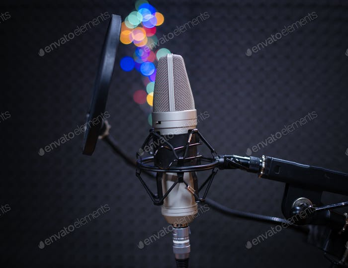 Professional microphone in a music studio made of metal for vocals, for a quiet and clear sound.