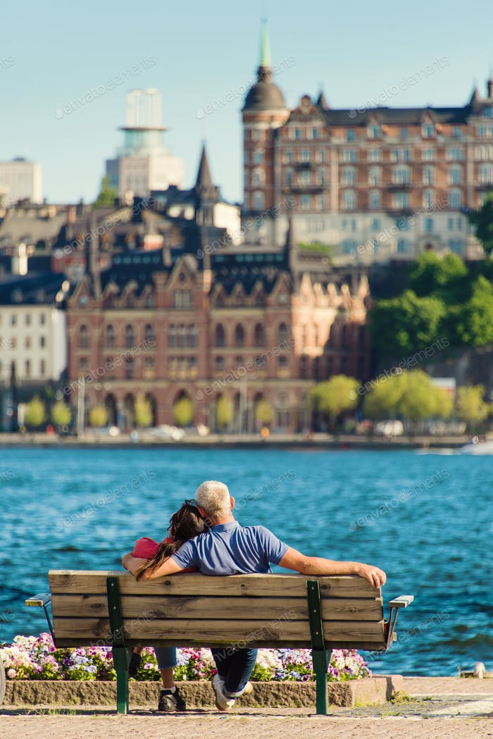 A couple seating on a bench. Stockholm